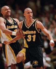 Reggie Miller and Mark Jackson celebrate Miller's huge ending against the Knicks.