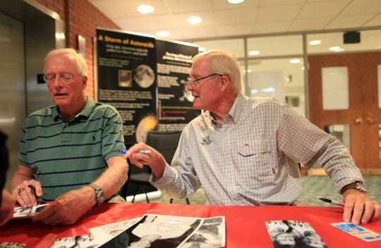 Retired NBA All-Stars Tom, left, and Dick Van Arsdale sign autographs at the Greenwood Library.