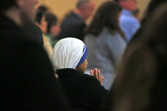 A nun prays during Ash Wednesday service at Saint John Catholic Church, Wednesday, February 10, 2016.