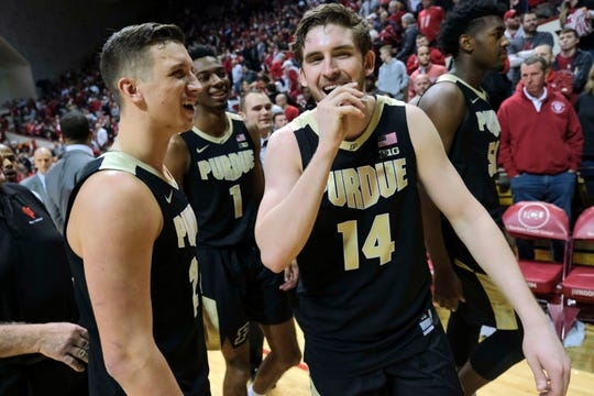 Purdue guard Ryan Cline, right, smiles with teammate Grady Eifert while leaving the court after Purdue defeated Indiana 48-46 on Feb. 19, 2019.