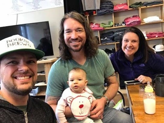 Books & Brews CEO Jason Wuerfel (from left) Stephen Fox, his wife Jordan Fox and daughter Layla Jean. Fox and his wife will open a Books & Brews location at the Hamilton Town Center in Noblesville.