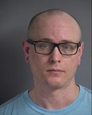 Travis Duwayne Ockenfels, 32, faces two counts of domestic abuse assault after being arrested Sunday night.