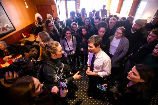 Pete Buttigieg, mayor of South Bend, Indiana, and 2020 Democratic presidential candidate, talks with Daily Iowan reporter Sarah Watson during an event March 4, 2019, at The Airliner in downtown Iowa City, Iowa.