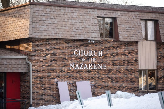 Boards cover graffiti on the Greater Iowa City Church of the Nazarene on Monday, March 4, 2019, at 1035 Wade Street, in Iowa City, Iowa. According to a news release from the Iowa City police the graffiti was believed to have occurred between 7:30 p.m. on Saturday and 8:15 a.m. on Sunday.
