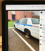 This photo of a Facebook post shows a Jackson Police Dept. car with the wheels missing at the Police Training Academy.