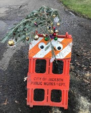 In this photo December 2017 photo, a pothole is decorated for the Christmas holiday season at the corner of St. Mary and Belmont streets in the Belhaven neighborhood of Jackson, Miss.