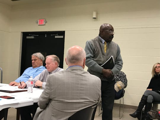 Hal Carter, standing, addresses the Madison County Election Commission on March 4, 2019, at the Madison County Agriculture Complex in Jackson.