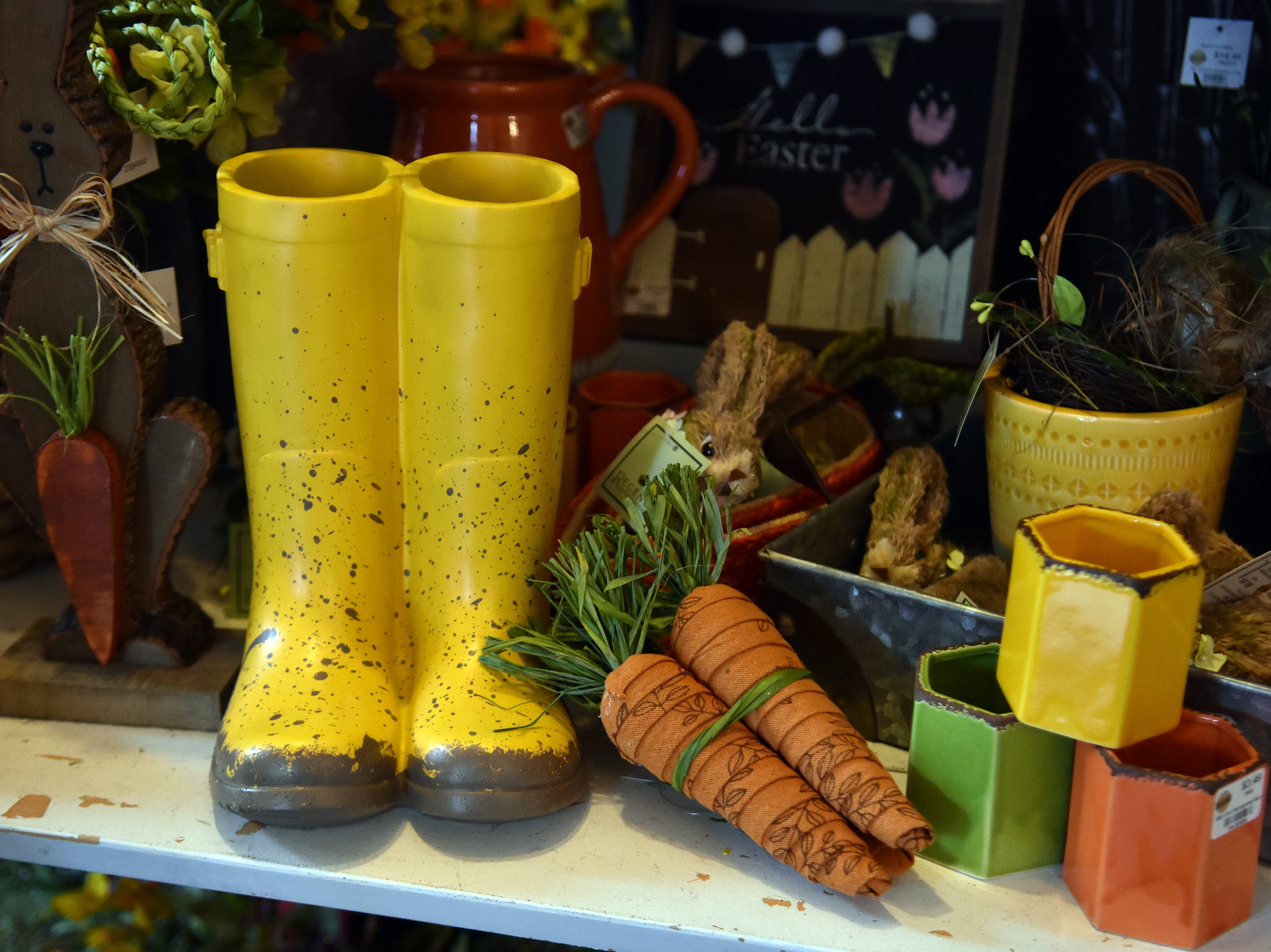 Yellow rain boots brighten up any rainy day. Check out the array of home decor items at Real Deals.