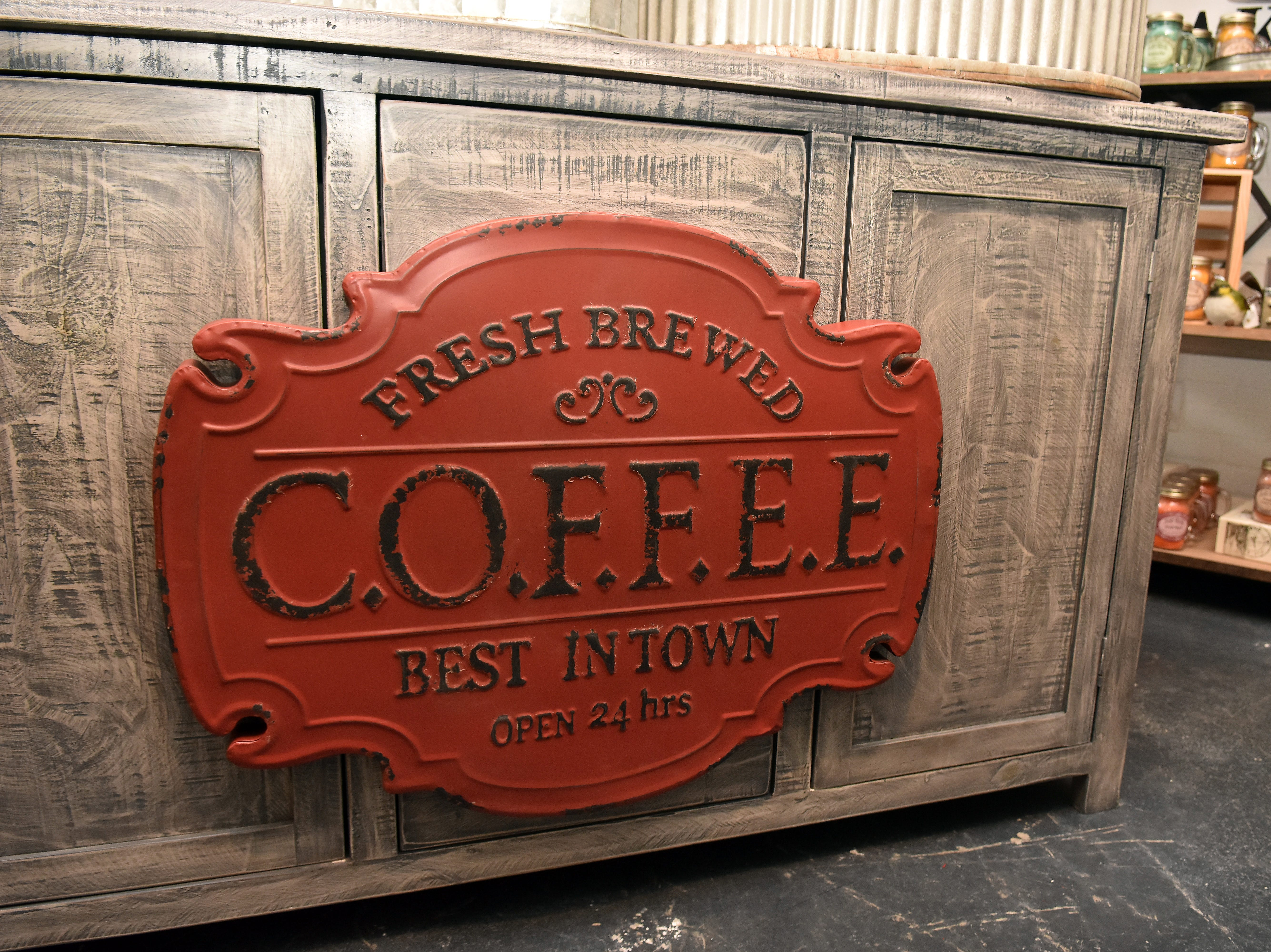 This sign from Real Deals is the perfect addition to any coffee lover's kitchen.