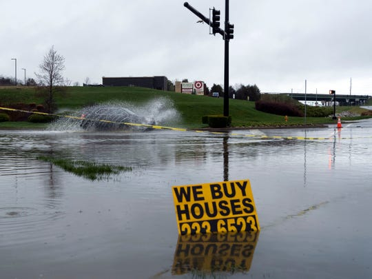 Rain water floods the entrance to Northshore Town Center at Northshore Dr. on Sunday, March 3, 2019.