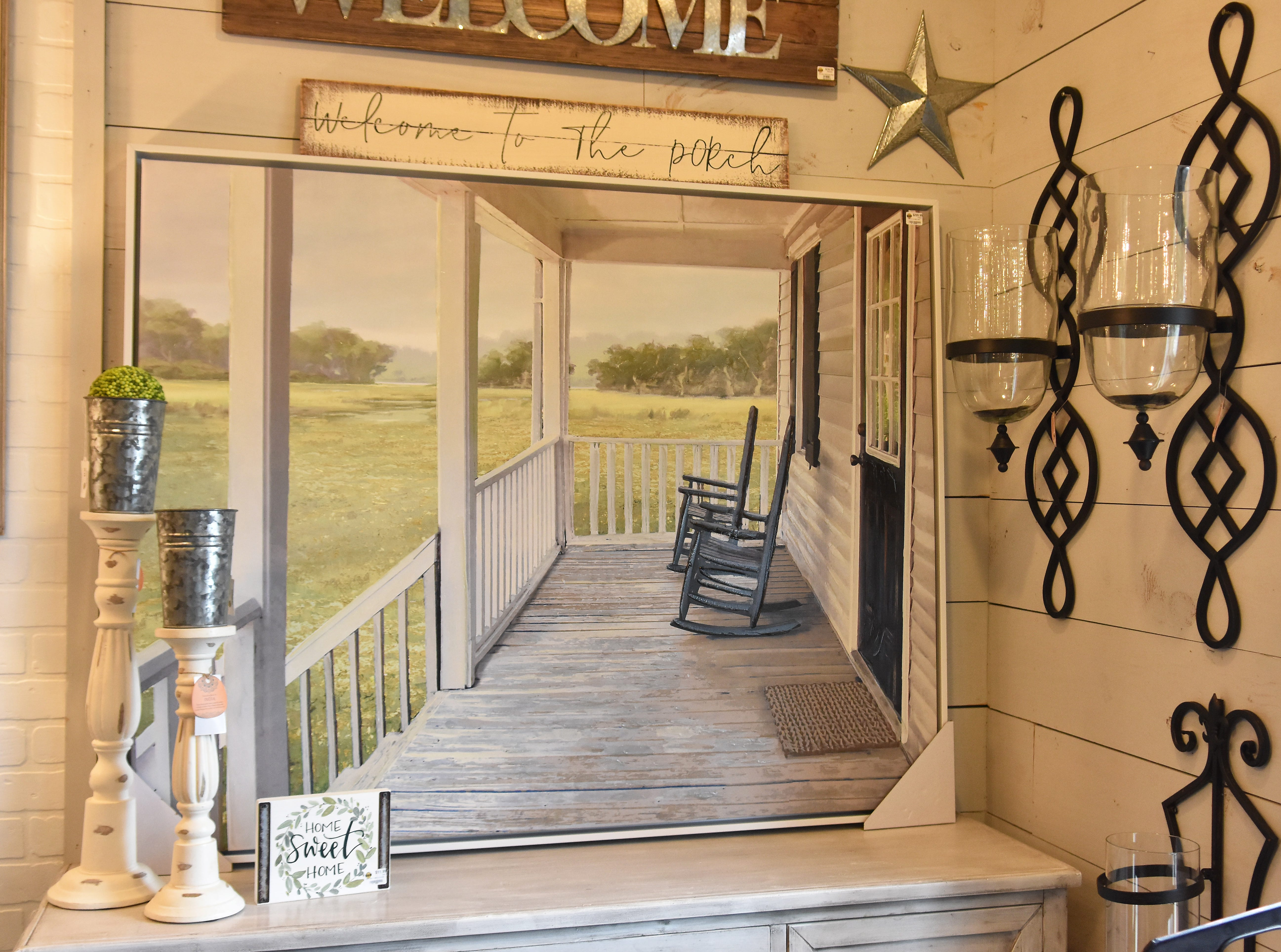 The painting of a front porch makes a nice focal piece over a hutch or side table.