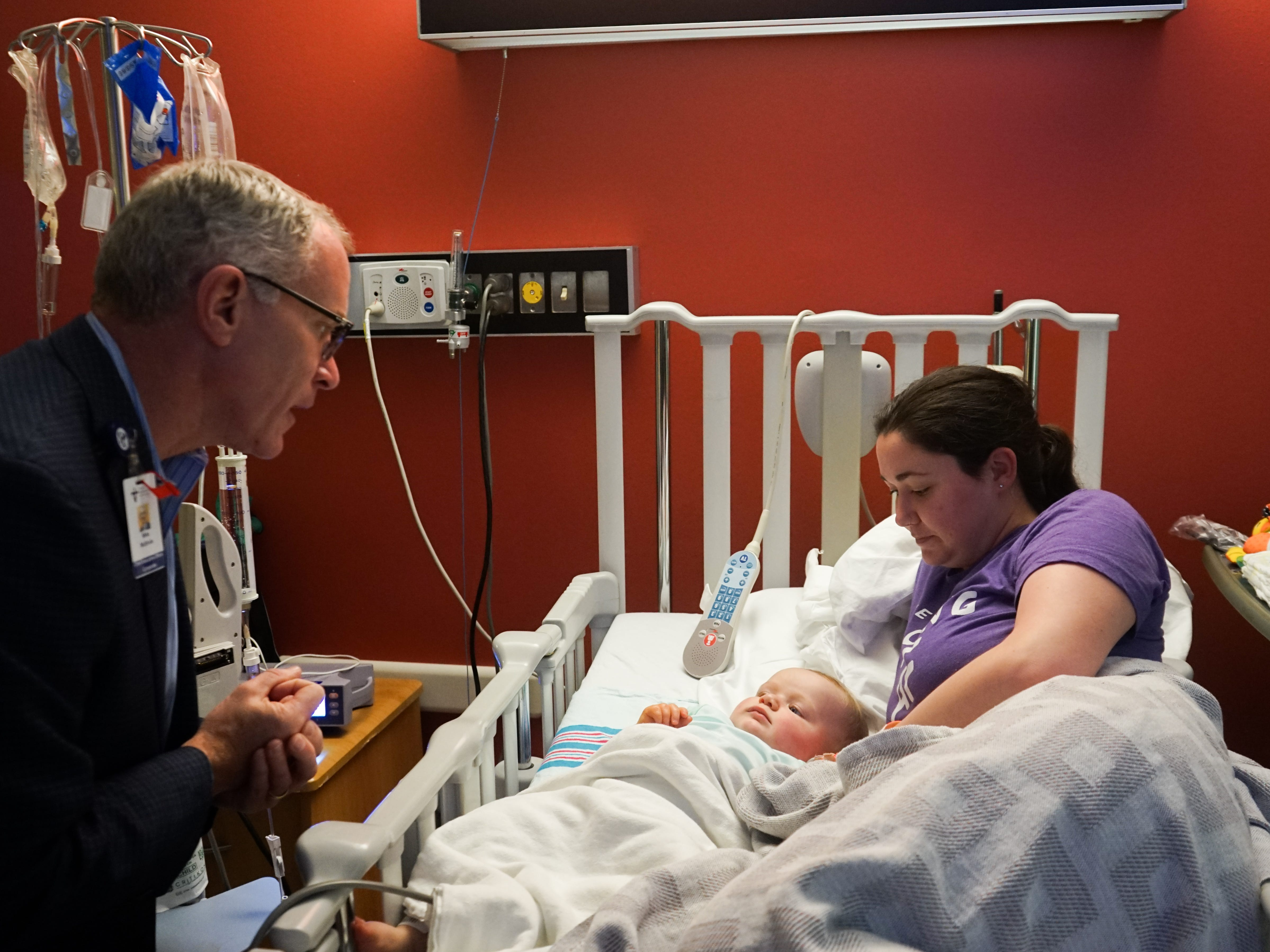 Mike McBride, chief executive officer for the Franciscan Missionaries of Our Lady Health System, visits with Oliver Henry and his mom, Elizabeth, in the Pediatrics department at Our Lady of Lourdes Women's & Children's Hospital on Friday, March 1. On Friday, the hospital became part of the local Our Lady of Lourdes system, which also is part of the Baton Rouge-based Franciscan Missionaries of Our Lady Health System.