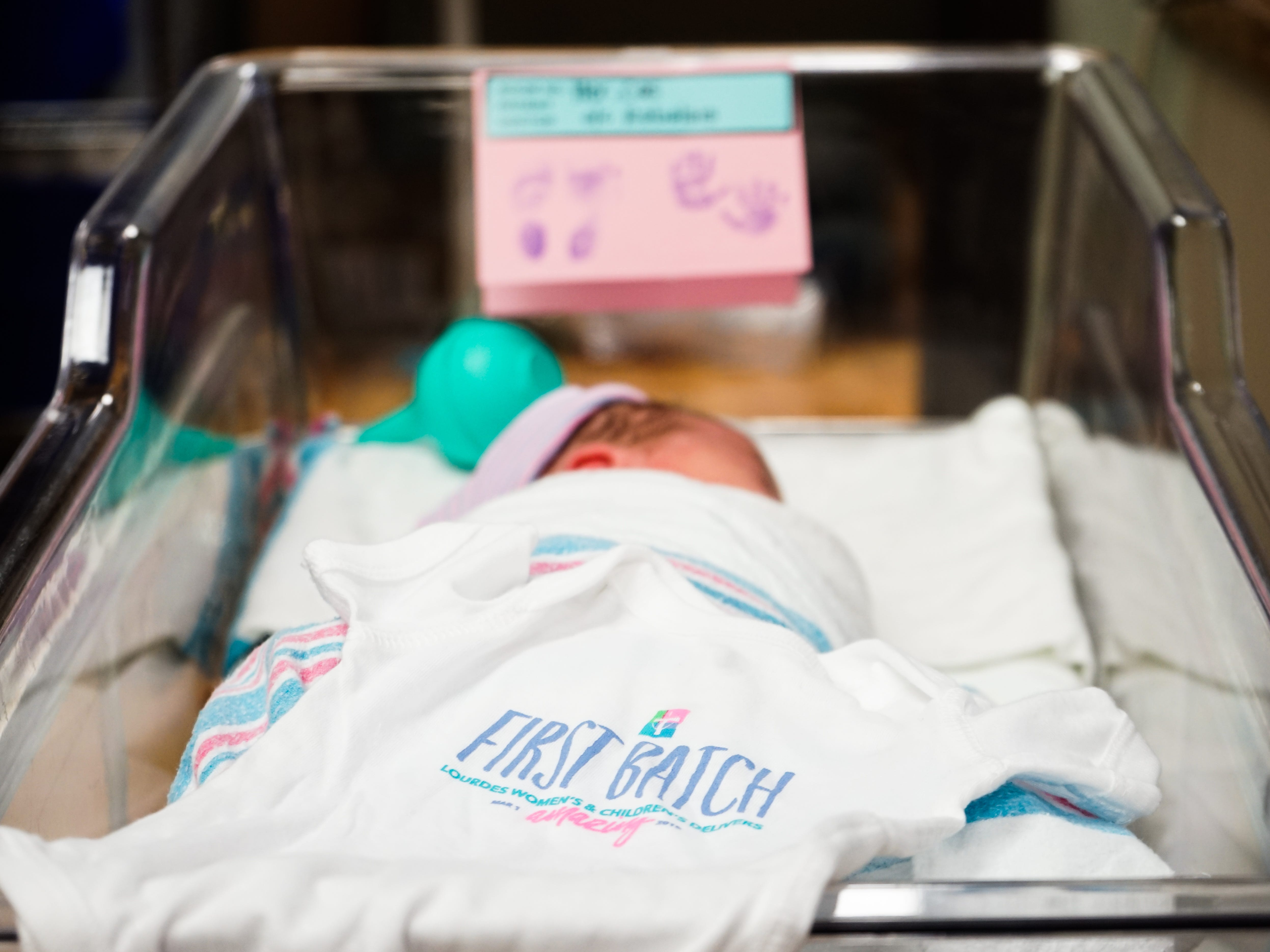"The ""first batch"" of babies born at Our Lady of Lourdes Women's & Children's Hospital on Friday, March 1, received a special onesie commemorating the hospital's first day as part of the Our Lady of Lourdes system."