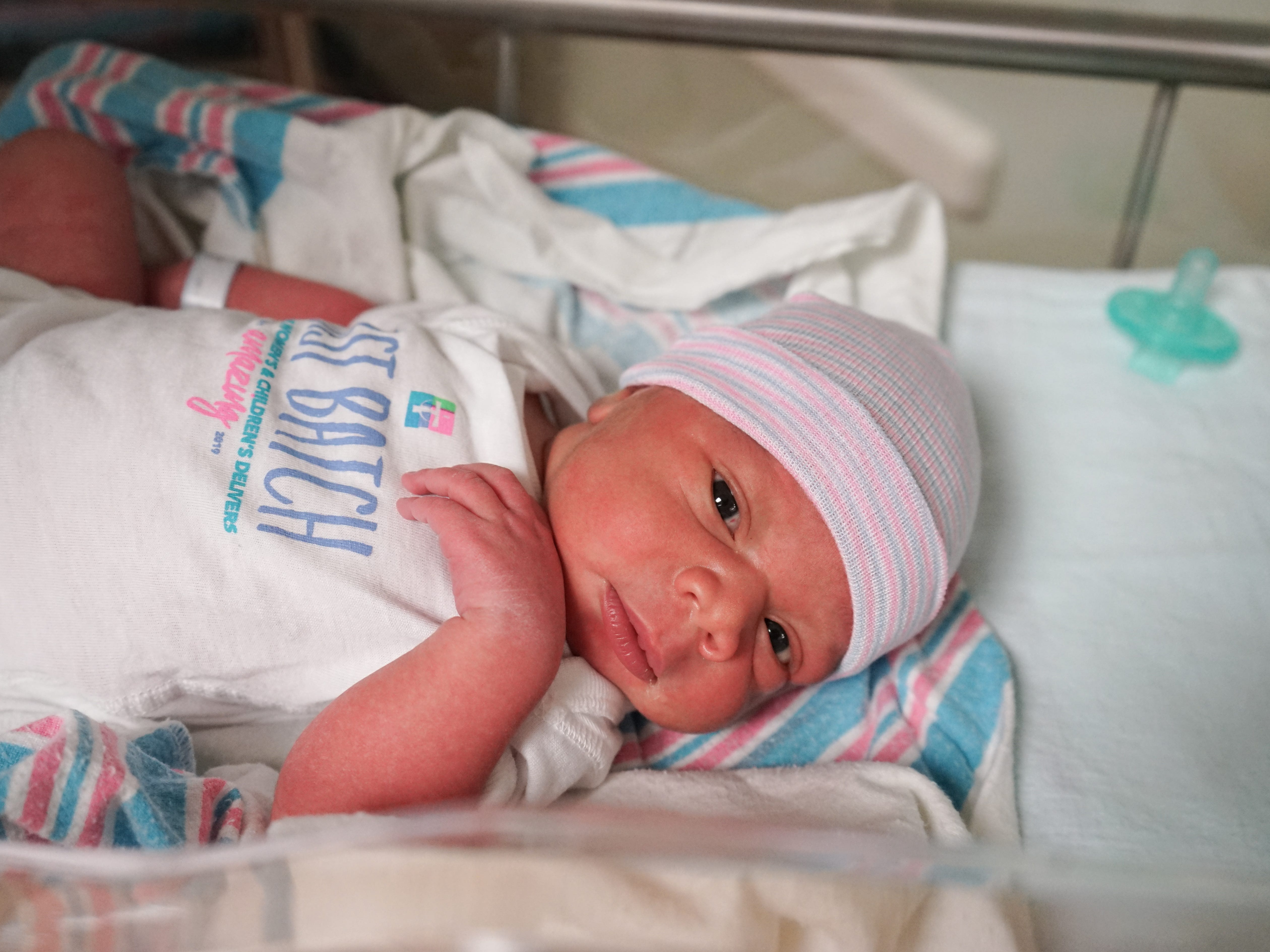 "Abigail Meagher entered the world at 12:51 a.m. on Friday, March 1, becoming the first baby born at Our Lady of Lourdes Women's & Children's Hospital. She weighed 7 pounds, 1.6 ounces and was 19 ¼ inches. All babies born at the hospital on Friday, March 1, received a special ""first batch"" onesie commemorating the hospital's first day as part of the Our Lady of Lourdes system."
