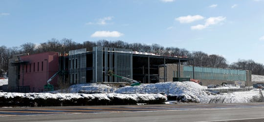 Contractors work on the Fairfield Medical Center River Valley Campus Monday, March 4, 2019, on Memorial Drive in Lancaster. The new three story building will house an emergency department, occupational and physical therapy services, community rooms, a women's health center and a joint fitness center with the Robert K. Fox Family YMCA.