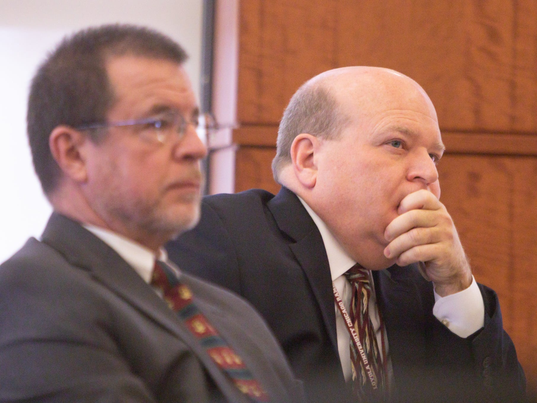 From left, Examiners Lynn Helland and Casimir Swastek listen to Dennis Kolenda, attorney for Judge Theresa Brennan during a JTC hearing Monday, March 4, 2019 in Detroit.