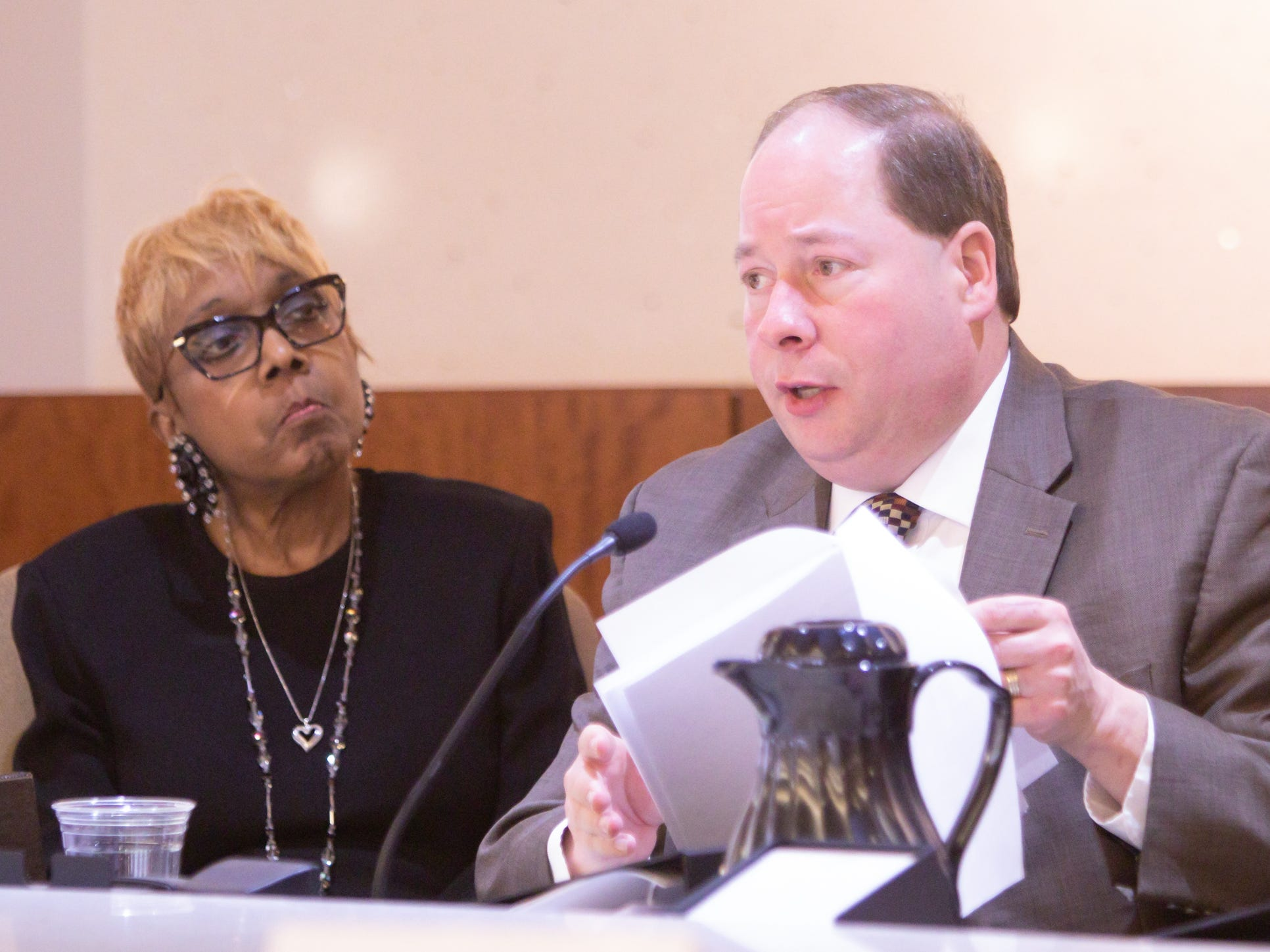 Judge Monte Burmeister, chairman of the Judicial Tenure Commission, speaks at a hearing Monday, March 4, 2019 over misconduct allegations involving Judge Theresa Brennan in Detroit as fellow commissioner and Judge Karen Fort Hood, secretary of the commission, listens.