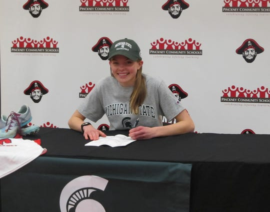 Pinckney's Noelle Adriaens has signed with Michigan State University to continue her running career.