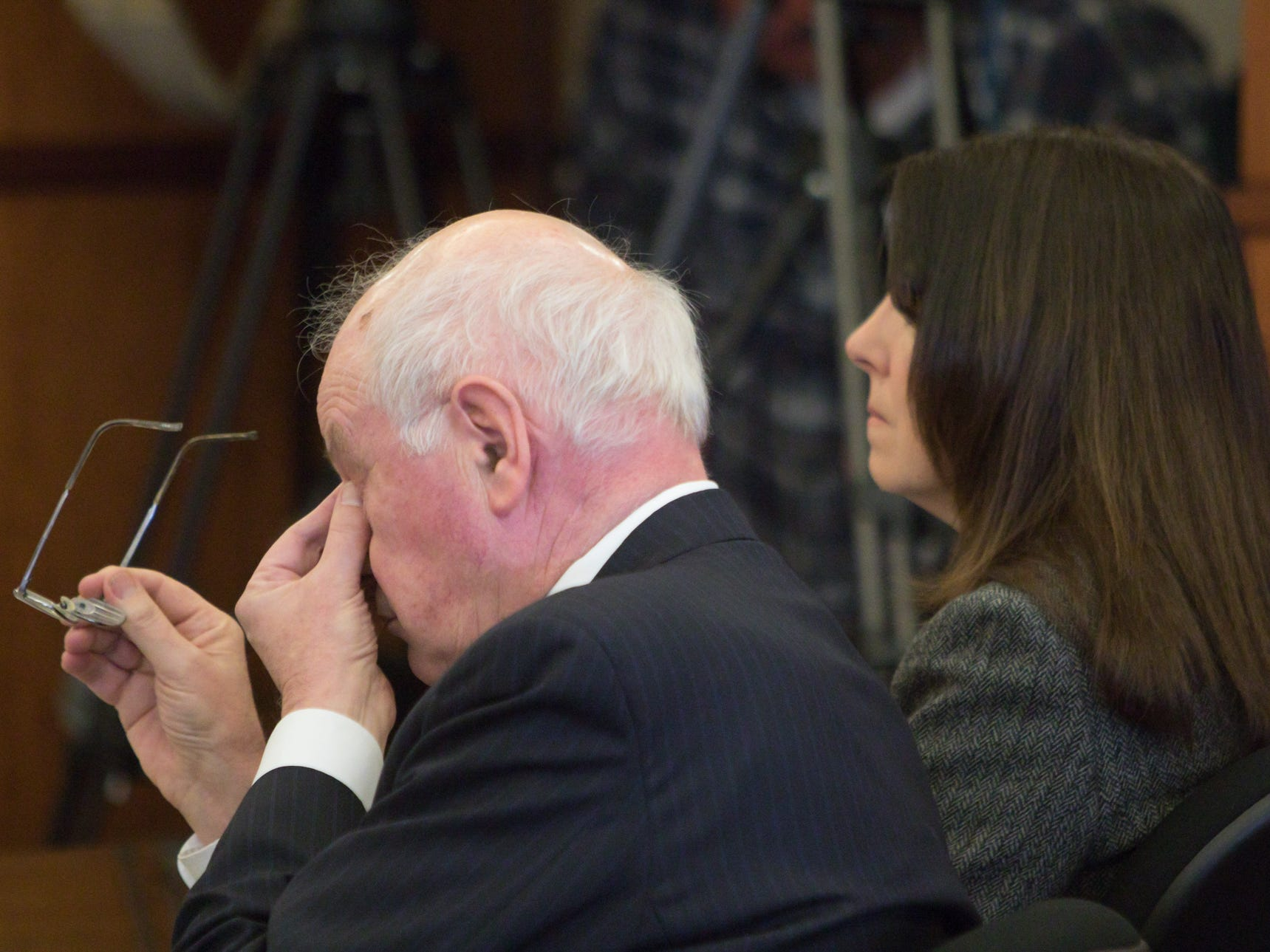Dennis Kolenda, attorney for Judge Therese Brennan seated to his right, wipes his eyes after both he and Judicial Tenure Commission Examiner Lynn Helland spoke in front of the commission Monday, March 4, 2019.