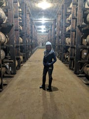 Courier Journal freelancer food writer Dana McMahan stands in the rickhouse at the MGP distillery in Lawrenceburg, Indiana, just outside Cincinnati.