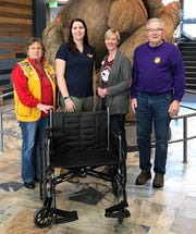 The Manitowoc Lions Club donated a wheelchair to Farm Wisconsin Discovery Center. Pictured from left: Manitowoc Lions Club Secretary JoAnne Bertsche, Farm Wisconsin Discovery Center Director of Operations Kim Kowieski, Farm Wisconsin Discovery Center Director of Marketing and Development Angel Johanek, and Manitowoc Lions Club member Roger Sisel.