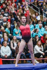 Stevens Point's Katelyn Trowbridge competes on floor exercise in Division 1 individual championships during WIAA state gymnastics competition in 2019.