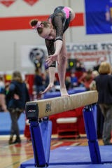 Marshfield's Gracie Holland competes on balance beam in Division 1 individual championships during WIAA state gymnastics competition in 2019. Holland is back to compete at state this year.