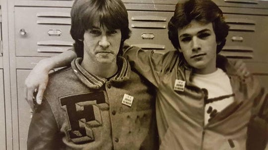 Actor Luke Perry, right, stands with his friend David Stewart inside Fredericktown High School in the early 1980s.