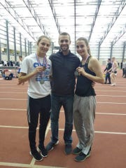 Galion state champion Kerrigan Myers, left, and Colonel Crawford runner-up Drew Krassow show off their medals at the state indoor meet with coach Matt Moore, who assists them in the high jump.
