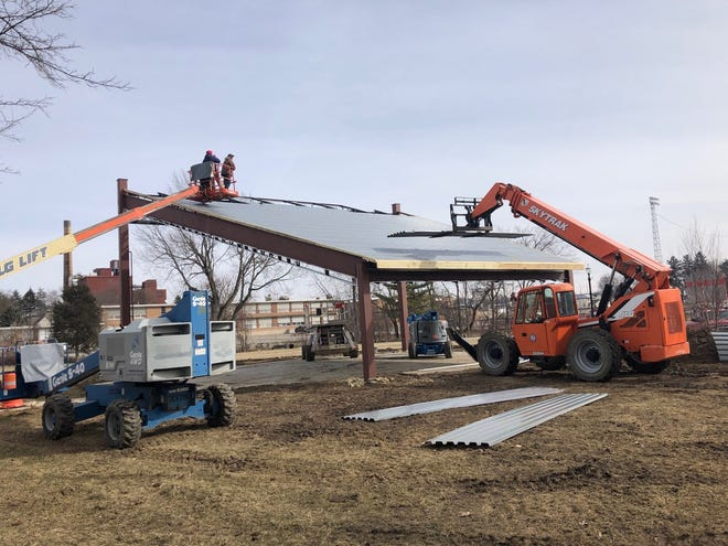 Crews work on the new stage at Black Fork Commons in Shelby. The structure is being built on the site where homes were flooded in 2007.
