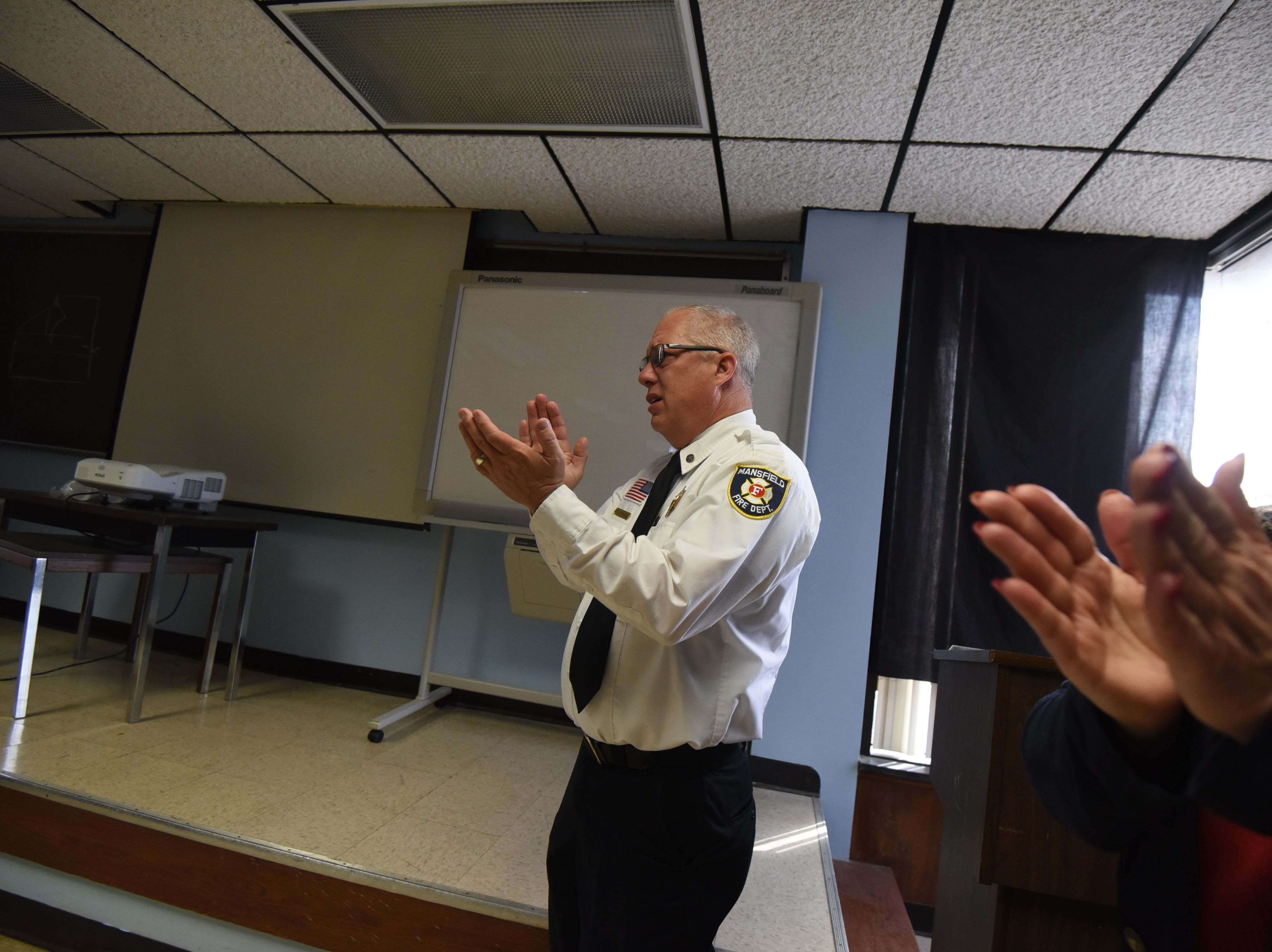 Images during a ceremony for the promotion of Joe Lucas to captain, and Michael Lifer to lieutenant.  Joshua Staats was sworn in, and Capt. George Rippey spoke on his last day before his retirement.