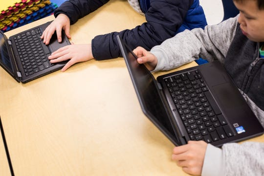 Students work on their Chromebooks at Lakeland Middle Preparatory School. Many districts are trying to get laptops or iPads into students' hands, and even to take home, but at least one study has shown that lack of supervision for take-home technology can have unwanted effects on students' test scores.