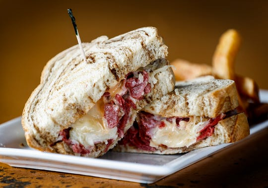 Celtic Crossing's corned beef sandwich. Imported corned beef with sauerkraut and Swiss on marble rye bread.