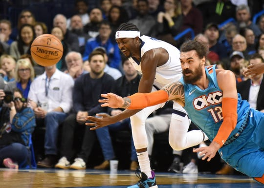 Oklahoma City Thunder center Steven Adams, right, tries to get to the ball before Memphis Grizzlies guard Justin Holiday, left, in the first half of an NBA basketball game, Sunday, March 3, 2019, in Oklahoma City. (AP Photo/Kyle Phillips)