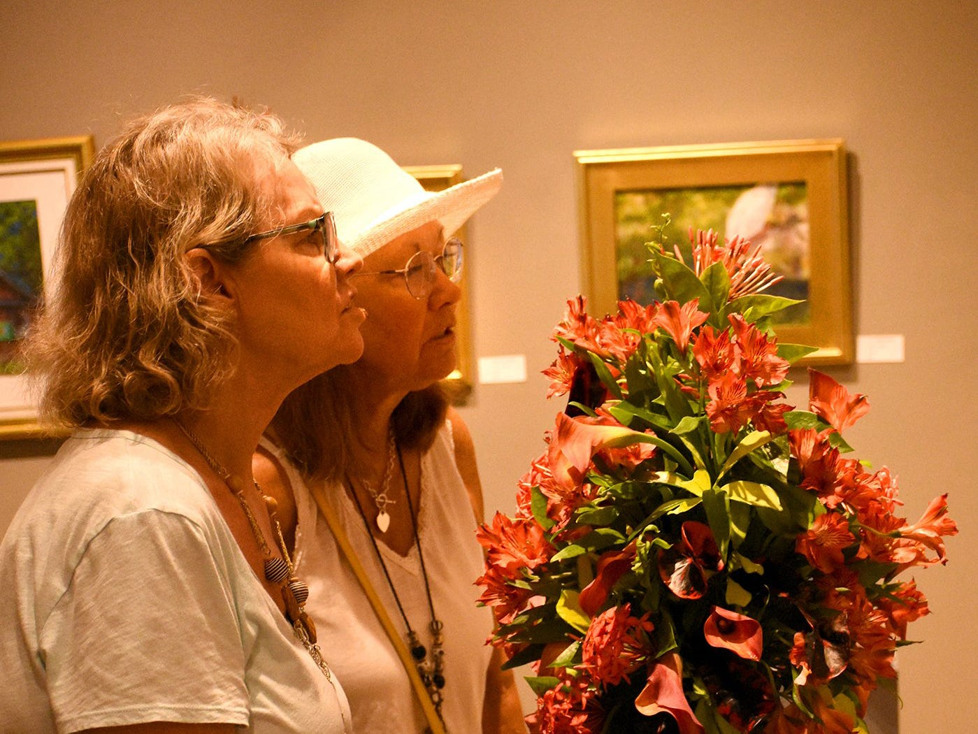 Victoria Gregory, left, and Fiona McMillan view arrangements and artwork. The Calusa Garden Club Gardening Expo at Marco Island Center for the Arts on Saturday displayed beautiful arrangements and showed people how to create their own.