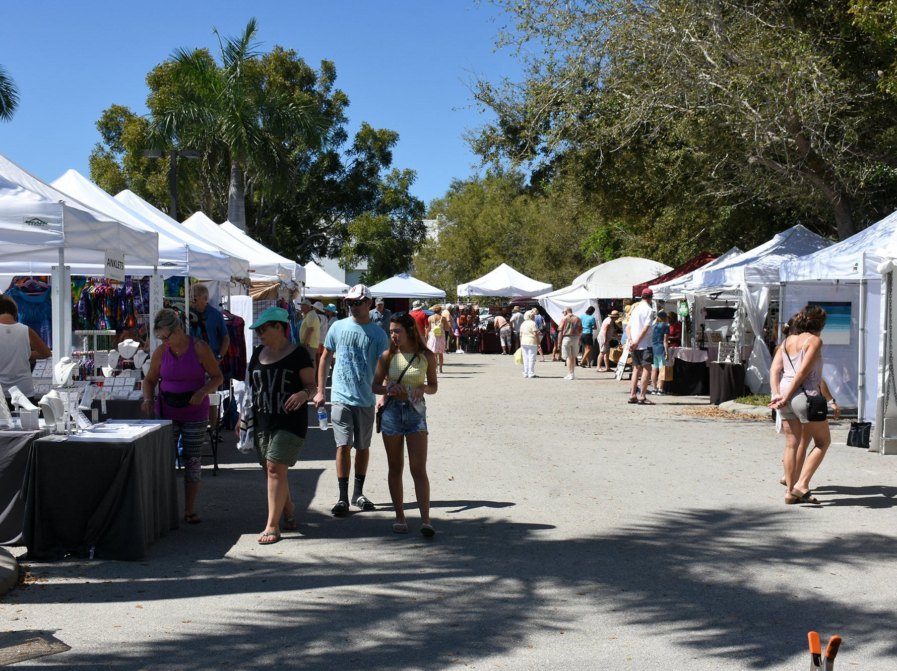 Out in the art center parking lot, a craft show lures additional visitors. The Calusa Garden Club Gardening Expo at Marco Island Center for the Arts on Saturday displayed beautiful arrangements and showed people how to create their own.