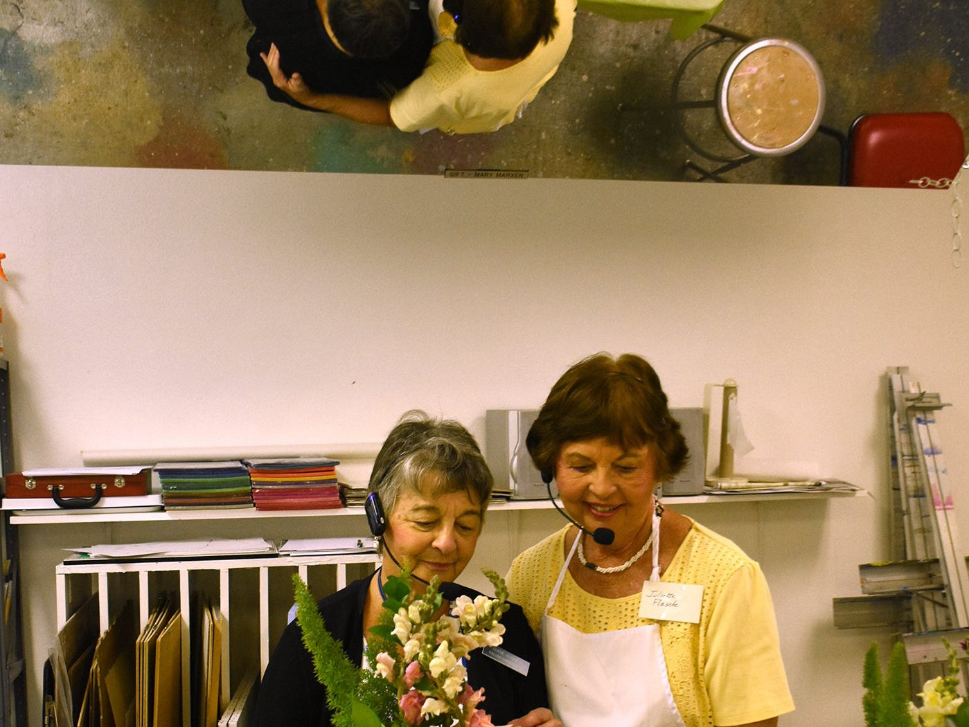 Diane Hughes, left, and Juliette Flasche lead a class on creating flower arrangements. The Calusa Garden Club Gardening Expo at Marco Island Center for the Arts on Saturday displayed beautiful arrangements and showed people how to create their own.