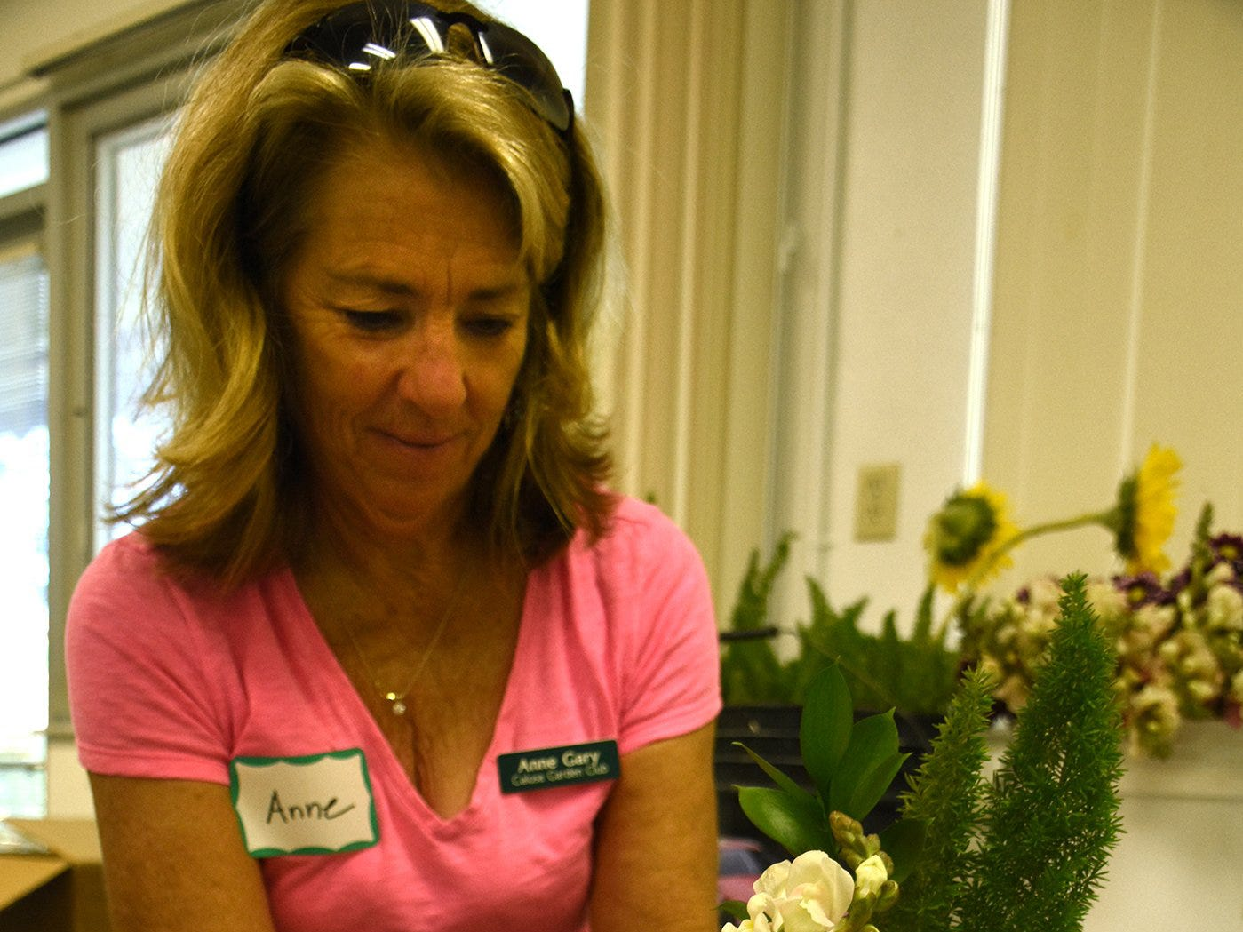Anne Gary works on her arrangement in a class led by Diane Hughes and Juliette Flasche. The Calusa Garden Club Gardening Expo at Marco Island Center for the Arts on Saturday displayed beautiful arrangements and showed people how to create their own.