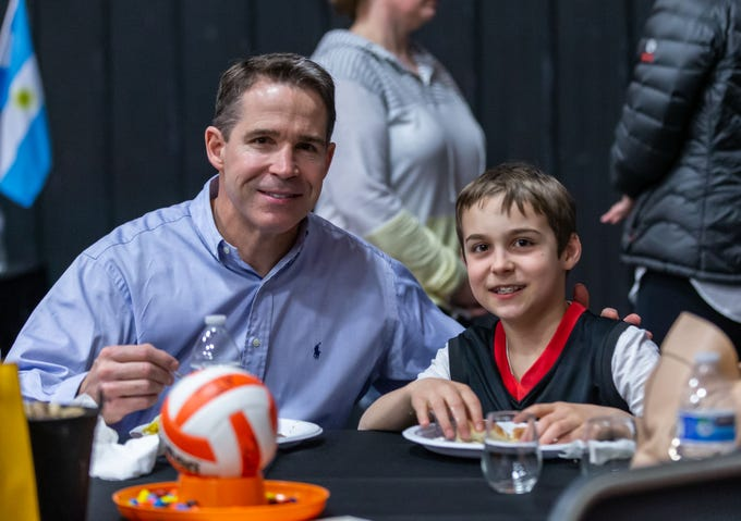 Jerry Dudzik and his son Joey, 10, of Germantown enjoy a catered dinner from the Texas Roadhouse during the annual wine tasting fundraiser hosted by Adversity-Wisconsin Volleyball Club in Germantown on Friday, March 1, 2019.