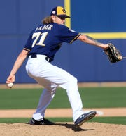 Milwaukee Brewers pitched for the first time in spring training Sunday.