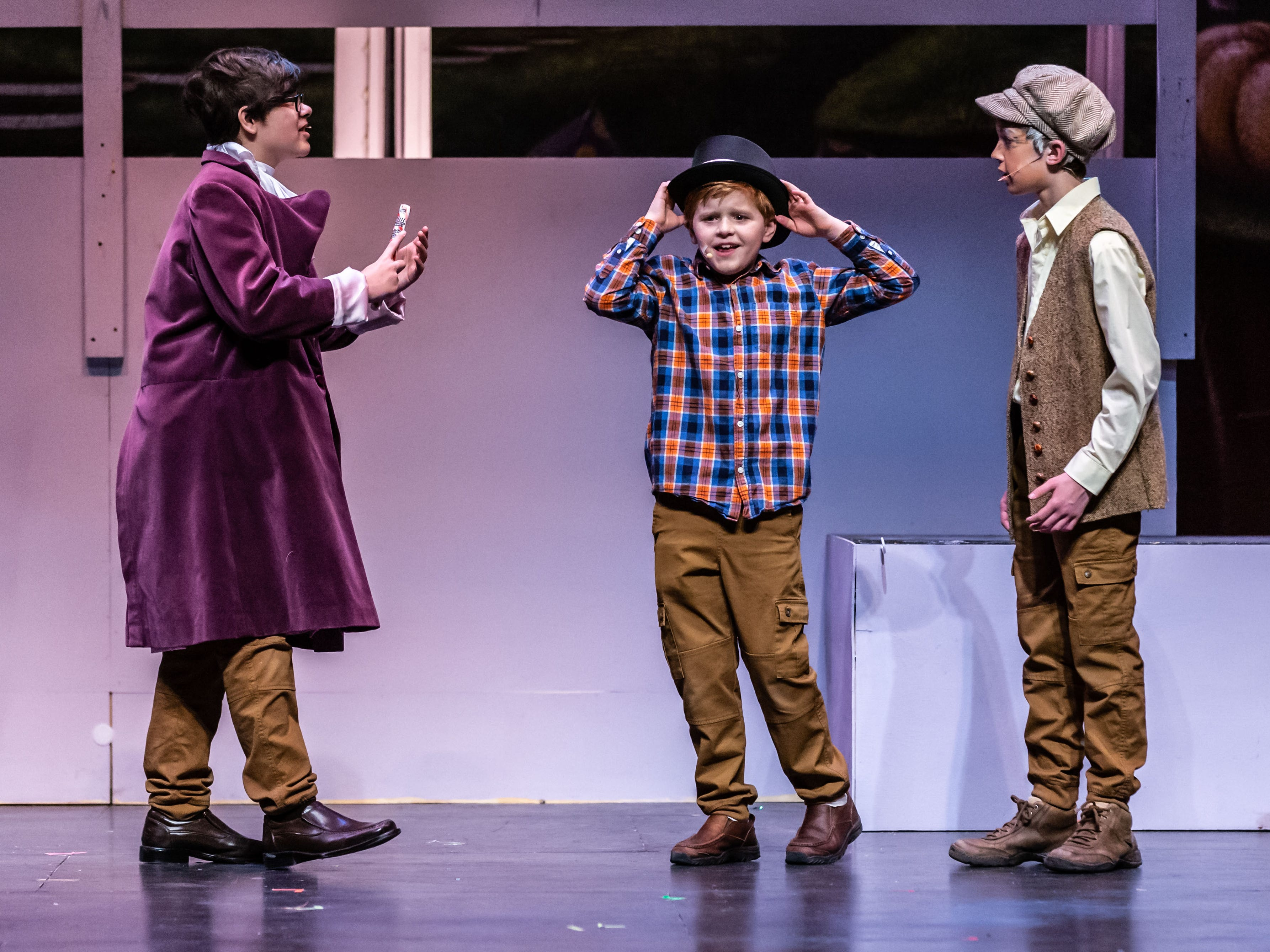 Brookfield Elementary students (from left), Aidan Riddle, Michael Foster and Derek Treis, portray Willy Wonka, Charlie Bucket and Grandpa Joe in a scene from Roald Dahl's Willy Wonka Jr. during rehearsal at the Sharon Lynne Wilson Center for the Arts in Brookfield on Saturday, March 2, 2019. Public performances are at 7 p.m. on March 2 and 2 p.m. on March 3.