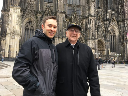 "Author Adam Makos with World War II veteran Clarence Smoyer in front of the cathedral in Cologne, Germany, in 2018. Makos has written ""Spearhead"" about Smoyer's experiences as a tank gunner in Europe."