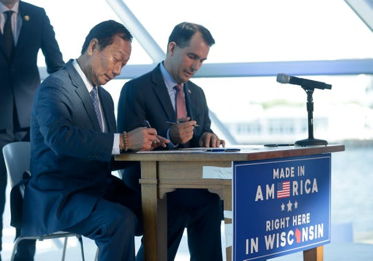 Foxconn Chairman Terry Gou (left) and then Governor Scott Walker signed a memorandum of agreement during the Foxconn announcement at the Milwaukee Art Museum to celebrate the state's investment to build a display panel plant in Wisconsin.
