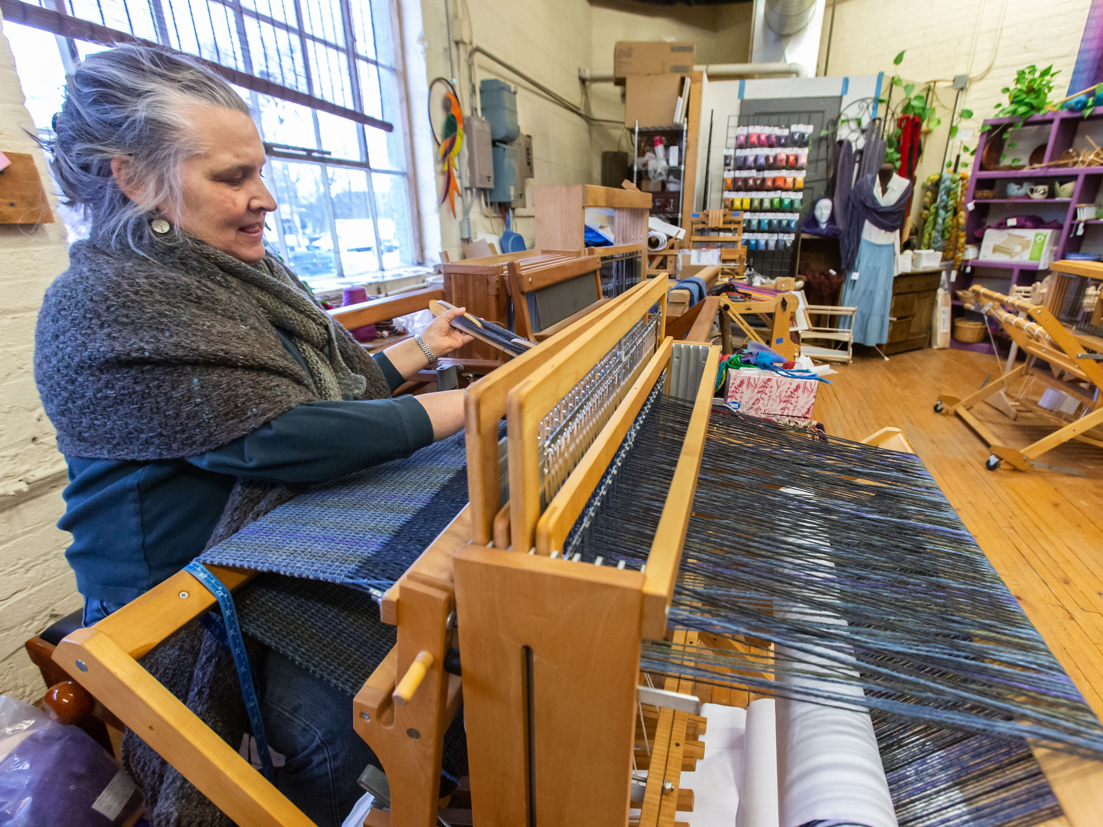 Nancy Wilson works on a loom at her Lost Art Fiber and Textile Studio located inside The Springs: Gallery/Studios in Waukesha during the Downtown Waukesha Art Crawl on Saturday, March 2, 2019.