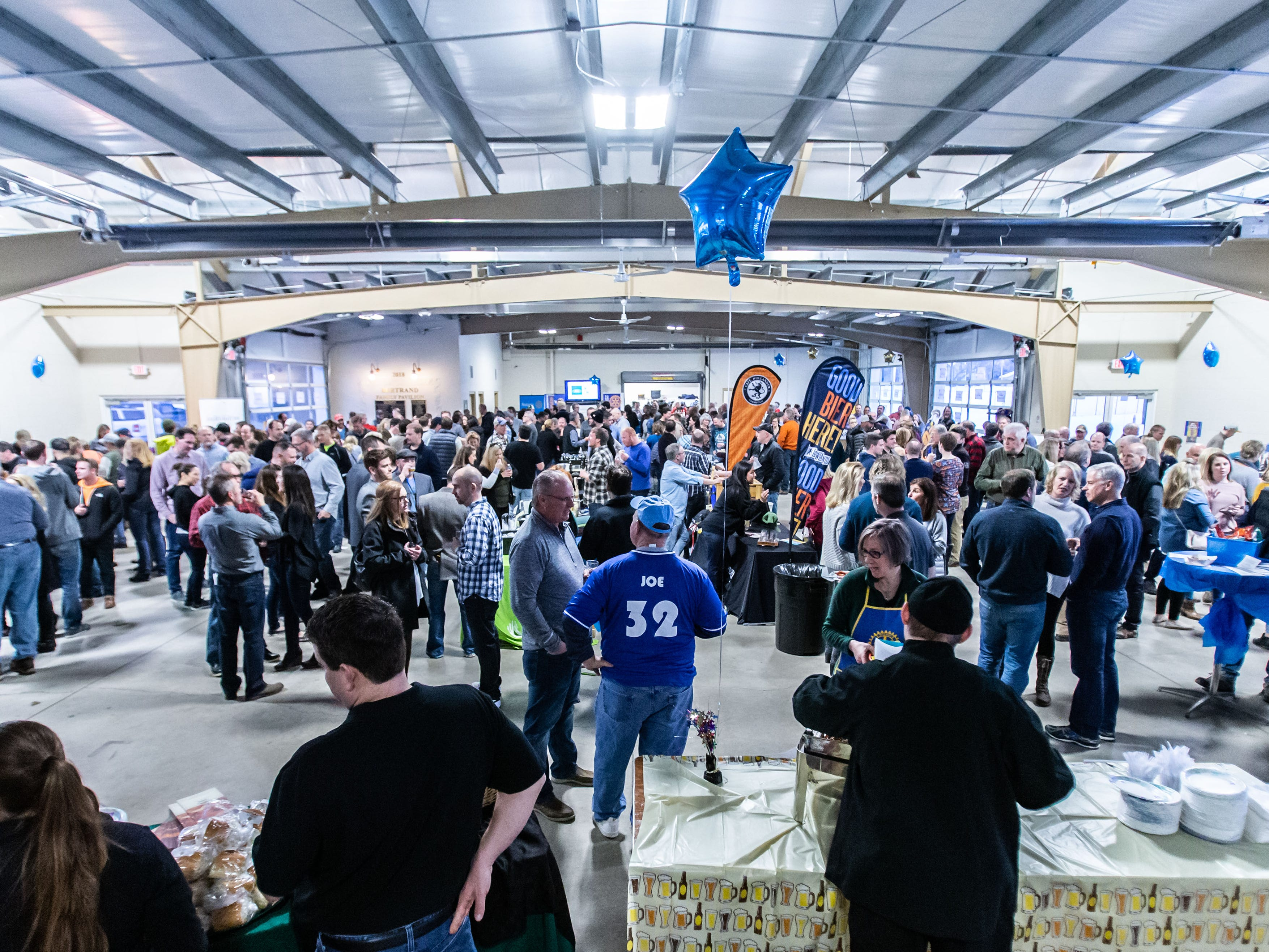 Attendees pack into the Bertrand Family Pavilion at Okauchee Lions Park for the Oconomowoc Rotary Club's 13th annual Oconomowoc Wine & Brewfest on Saturday, March 2, 2019.