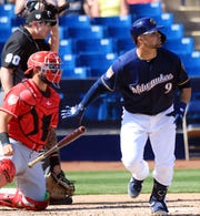 Milwaukee Brewers catcher Manny Pina watches his solo home run.