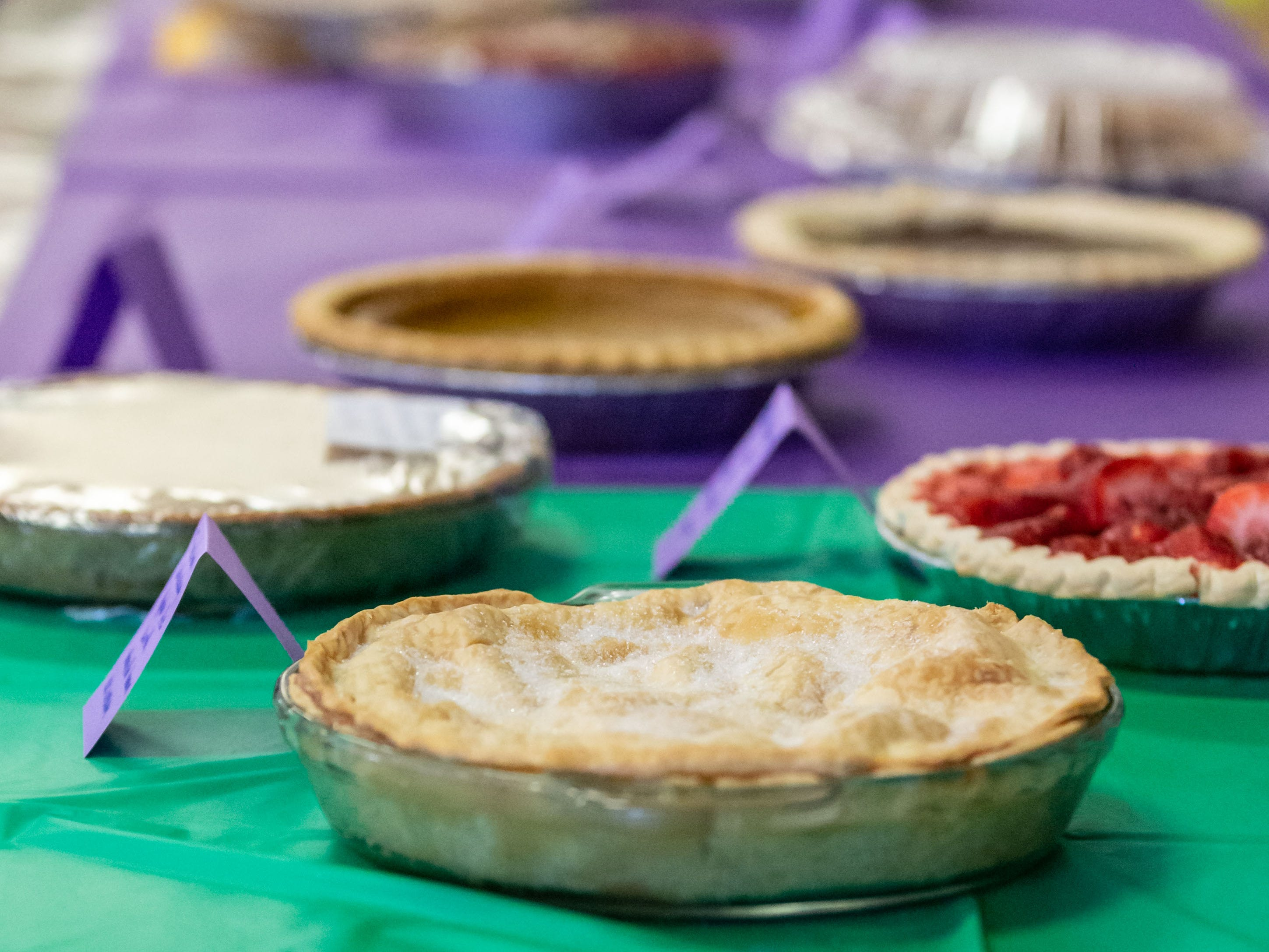 A table of home-baked pies tempt guests during the Mardi Gras Pig Roast and pie auction at Immanuel Lutheran Church in Cedarburg on Sunday, March 3, 2019. The event is a fundraiser for the church.