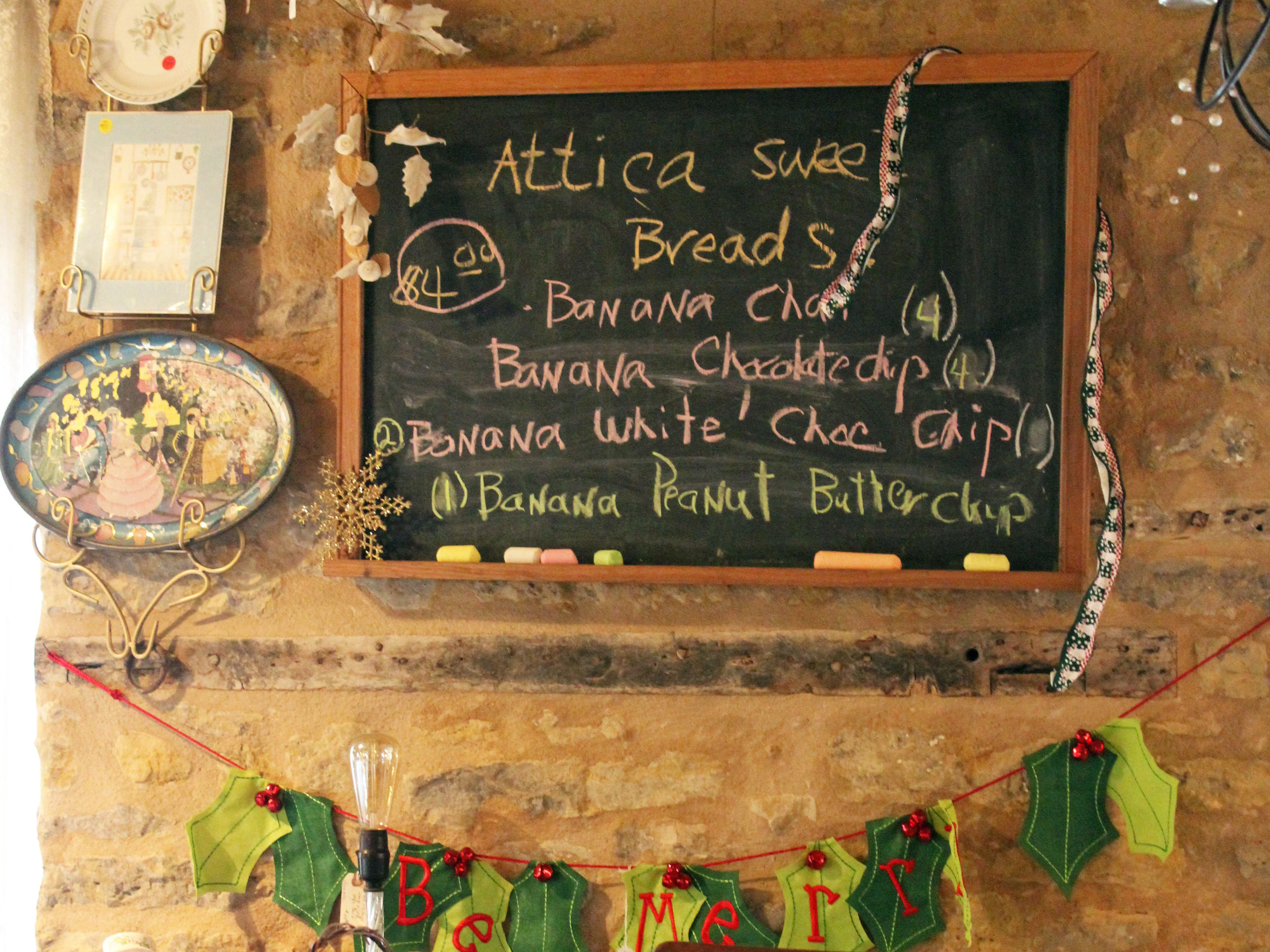 Sweet breads of the day are noted on a chalkboard inside Franklin Grove Etc.