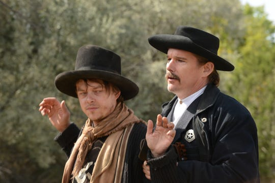 "Dane DeHaan (left) is Billy the Kid and Ethan Hawke is lawman Pat Garrett in ""The Kid."""