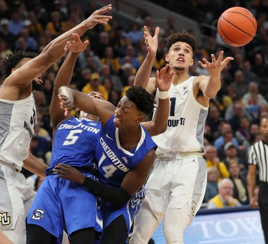 March 3, 2019 Marquette vs. Creighton at the Fiserv Forum in Milwaukee.  Marquette's Brendan Bailey attempts to get control of a loose ball. Marquette had 22 turnovers.